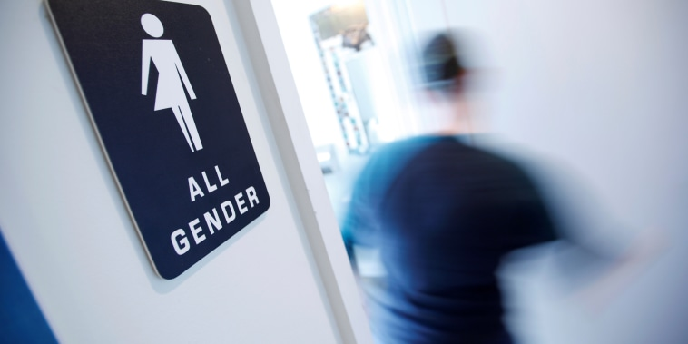 A bathroom sign welcomes both genders at the Cacao Cinnamon coffee shop in Durham North Carolina
