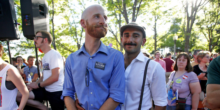 Derek Kitchen and his husband Moudi Sbeity celebrate the United States Supreme Court's landmark decision that legalized same-sex marriage throughout the country in Salt Lake City