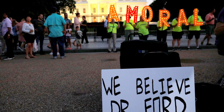 Image: #KremlinAnnex protesters place a sign referring to Christine Blasey Ford outside the White House in Washington