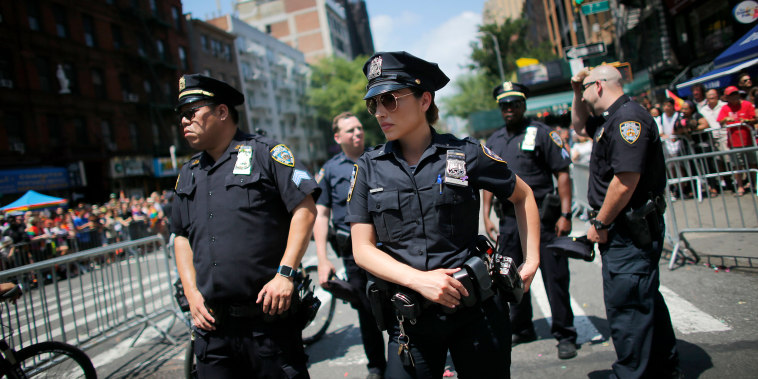 NYPD officers stand watch on Seventh Avenue during the annual Pride Parade on June 24, 2018 in New York City.