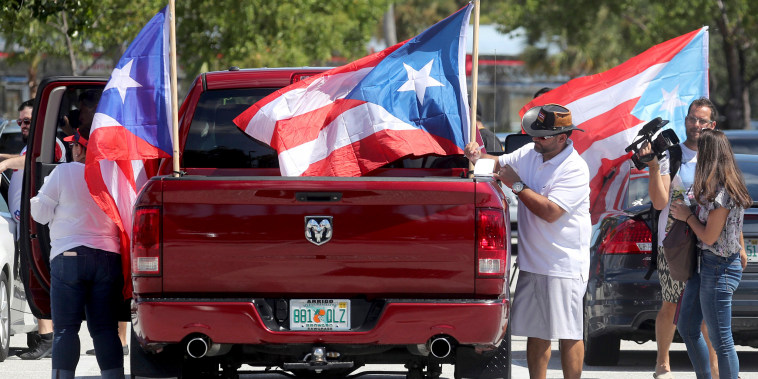 Image: People gather in the parking lot and get ready to head to West Palm Beach for a protest Sept. 22, 2018 in Hollywood, Florida.