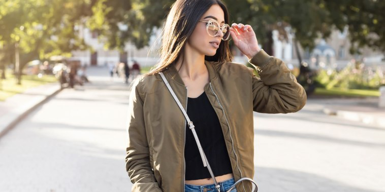 Woman in bomber jacket