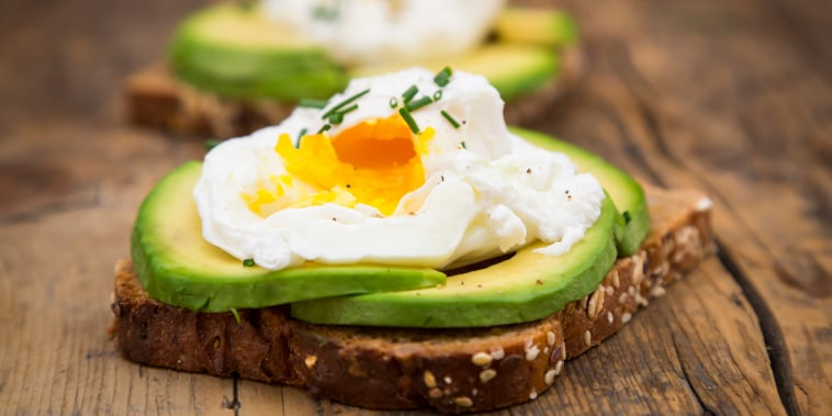 Bread slices with sliced avocado and poached eggs