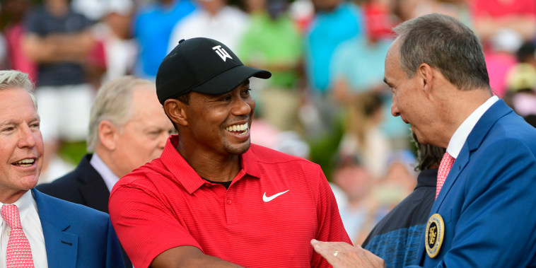 Image: Tiger Woods is congratulated after winning the Tour Championship golf tournament  is congratulated after winning the Tour Championship golf tournament
