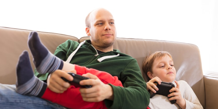 Image: Parent, child Playing video games