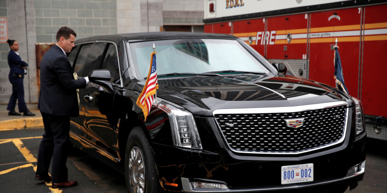 "Image: Secret Service agent cleans U.S. President Donald Trump's new Cadillac limousine nicknamed ""The Beast"" before debut drive in New York City"
