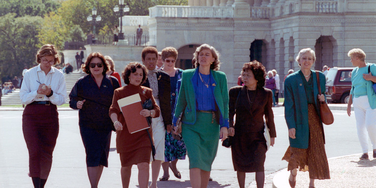 Rep. Patricia Schroeder, D-Colo., center, leads a delegation of congresswomen from the House to the Senate on Capitol Hill to voice their concerns on the nomination of Clarence Thomas