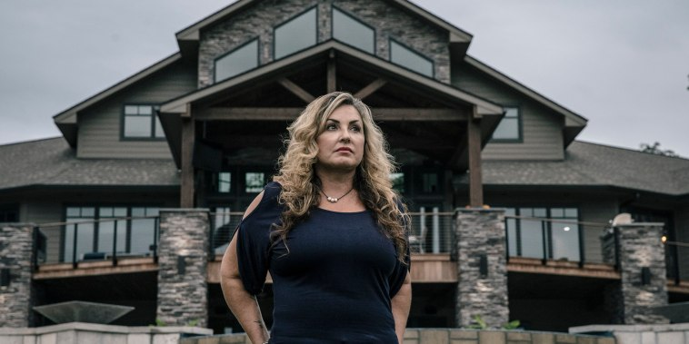 Image: Heather Melton stands for a portrait at the home she built with her husband Sonny Melton