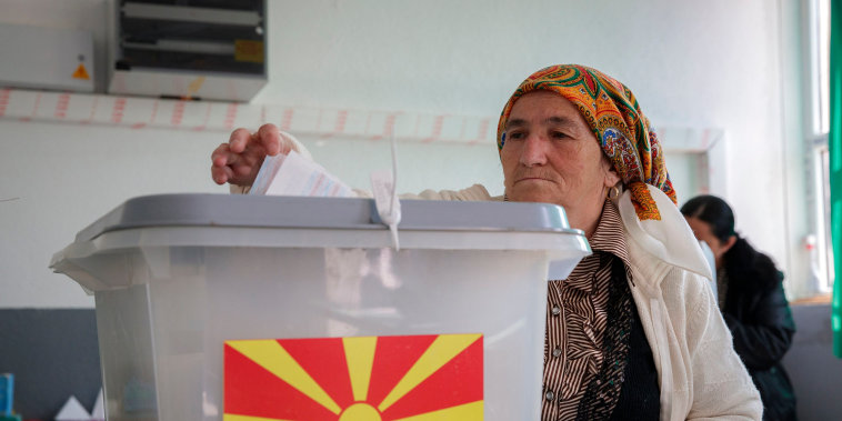 A woman casts her vote in the referendum.