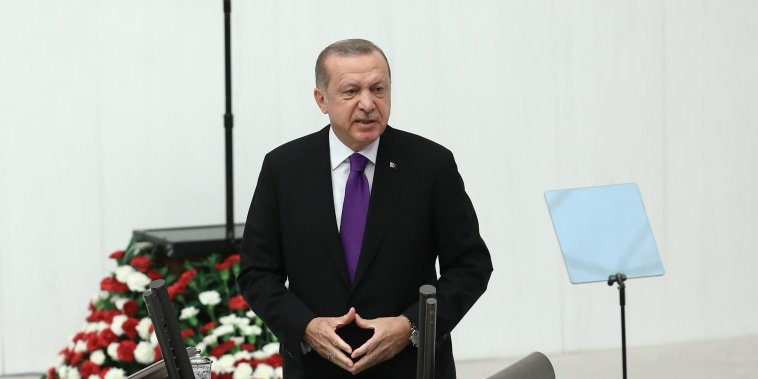 Image: The President of Turkey, Recep Tayyip Erdogan, addresses Turkish members of the parliament during the opening of the second legislative year of the 27th Term of Grand National Assembly of Turkey