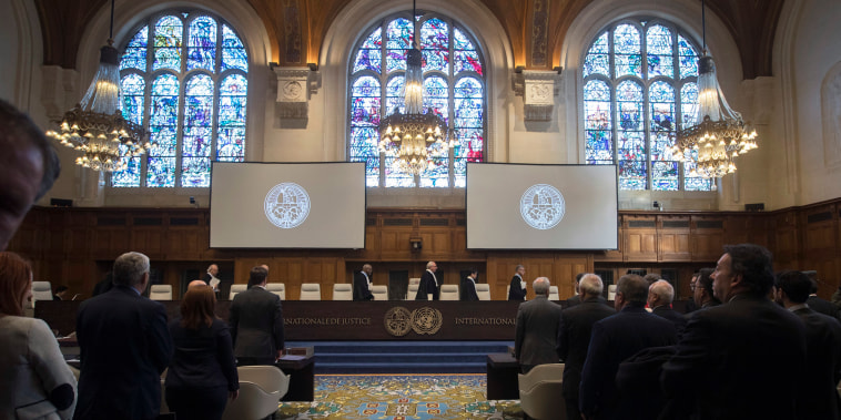 Image: The delegations of the U.S. and the Islamic Republic of Iran rise as judges enter the International Court of Justice