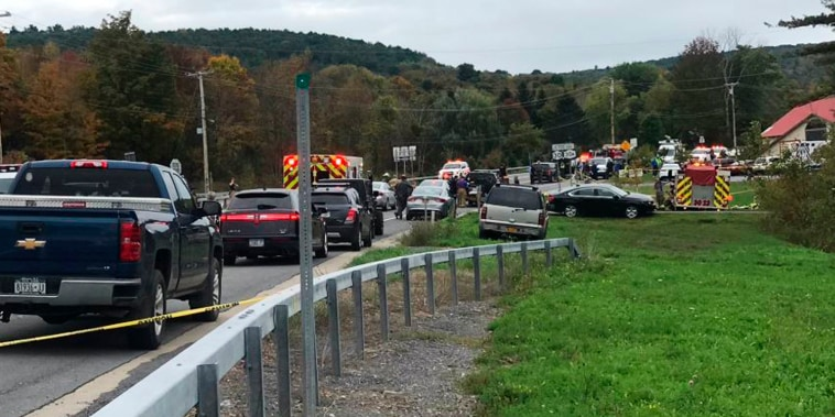 Emergency personnel respond to a deadly limousine crash Oct. 6 in Schoharie, New York.