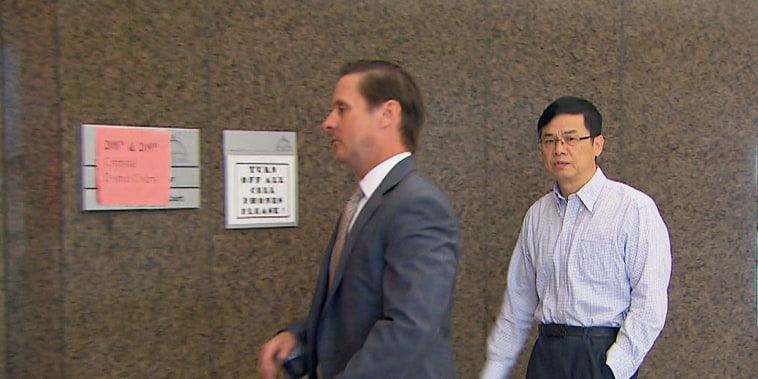 Keping Xei with his attorney Nathan Mays in Houston on Oct. 3.