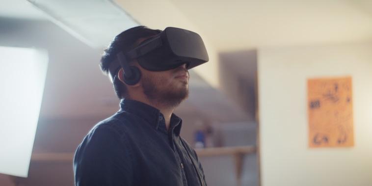 Frisly Soberais using a VR headset.