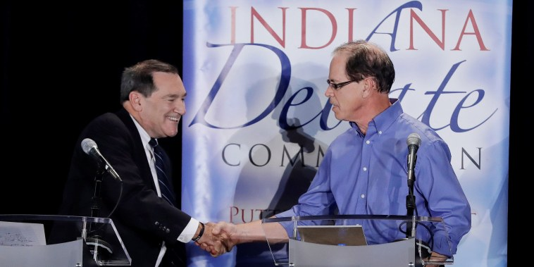 Image: Democratic U.S. Sen. Joe Donnelly shakes hands with Republican former state Rep. Mike Braun following a U.S. Senate Debate in Westville Indiana