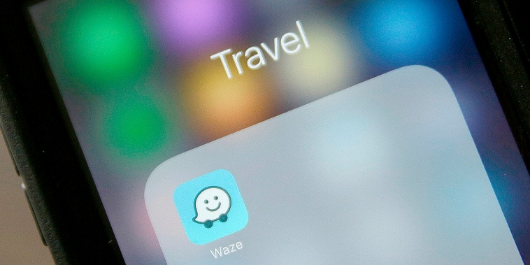 The Waze application is displayed on a smartphone in San Francisco on March 27, 2017.