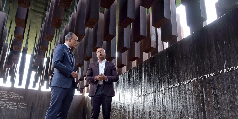 Lester Holt and Bryan Stevenson stand in the National Memorial for Peace and Justice on Oct 9, 2018.