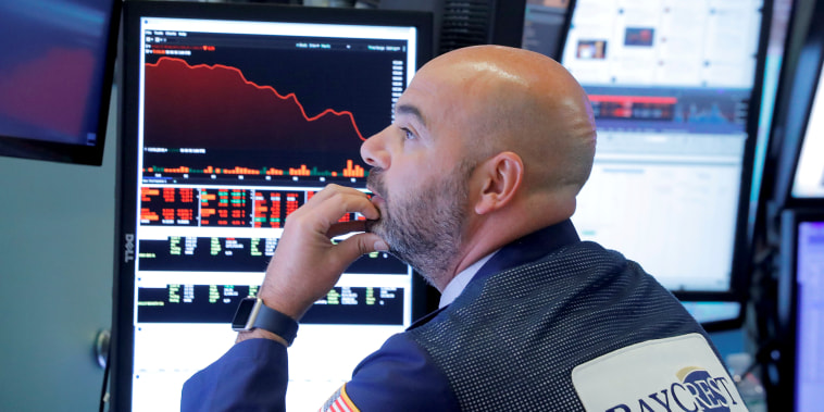 Image: A trader works on the floor of the New York Stock Exchange (NYSE) in Manhattan in New York