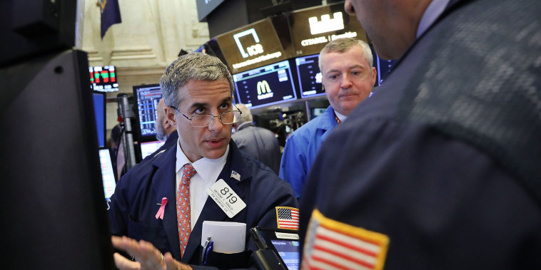 Image: Traders work on the floor of the New York Stock Exchange (NYSE) on the morning of Oct. 11, 2018 in New York City