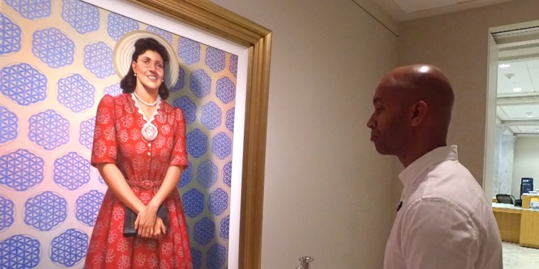 Artist Kadir Nelson looks at his portrait of Henrietta Lacks hanging in the Smithsonian National Portrait Gallery in Washington, D.C.