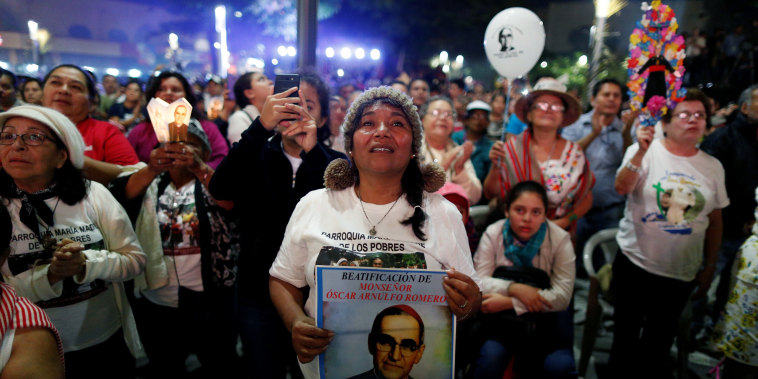 Image: People watch the ceremony of canonization of the late Archbishop of San Salvador Oscar Arnulfo Romero at the Gerardo Barrios Square in San Salvador