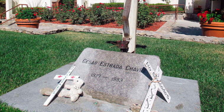 The grave of Chicano farmworker leader Cesar Chavez in the memorial garden at La Paz, the United Farm Workers of America headquarters, now the Cesar E. Chavez National Monument, in Keene, California. The site of his birthplace sits abandoned in Yuma, Arizona.