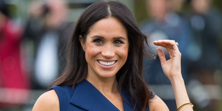 Duchess Meghan showing