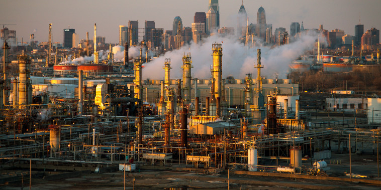 The Philadelphia Energy Solutions oil refinery owned by The Carlyle Group is seen at sunset in front of the Philadelphia skyline March 24, 2014.