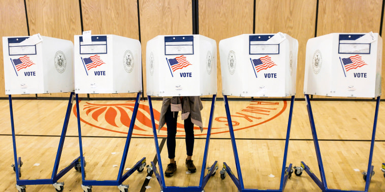 Image: A person fills out a ballot during primary election voting in New York on Sept. 13, 2018.