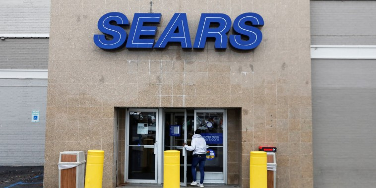 Image: A person walks into a Sears store in Brooklyn, New York