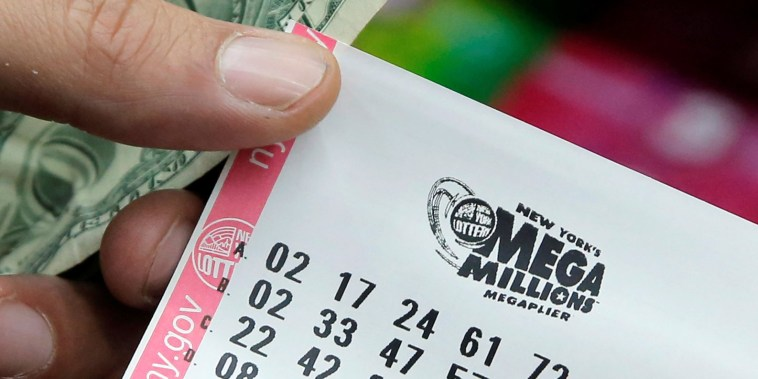 Image: A ticket is seen ahead of the Mega Millions lottery draw which reached a jackpot of $415 Million in Manhattan, New York, U.S.