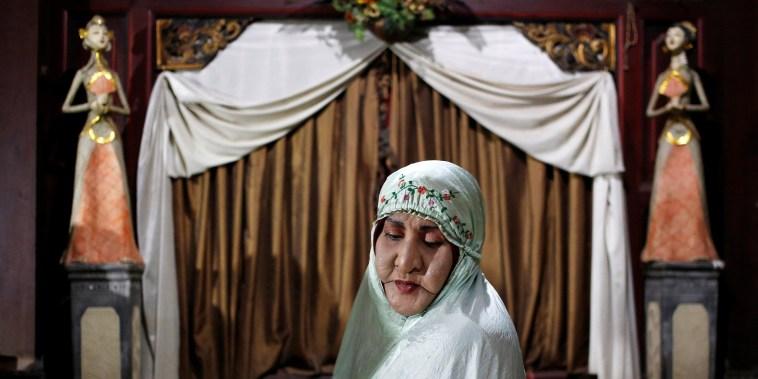 Image: Shinta Ratri, owner of Islamic boarding school for transgender women, sits in prayer in Yogyakarta