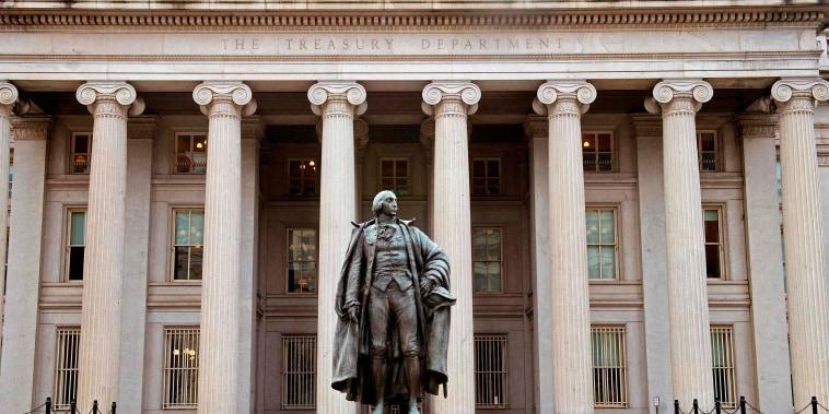 Image: A man enters the U.S. Treasury Department building on Pennsylvania Avenue  in Washington, DC on Jan. 24, 2017.