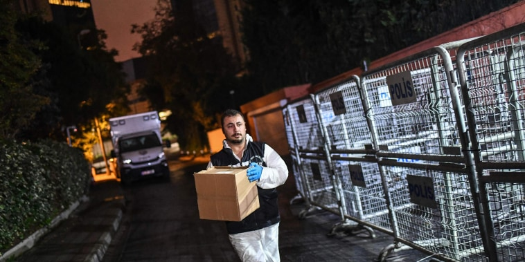 Image: A Turkish forensic police officer carries a box at the Saudi Arabian consulate