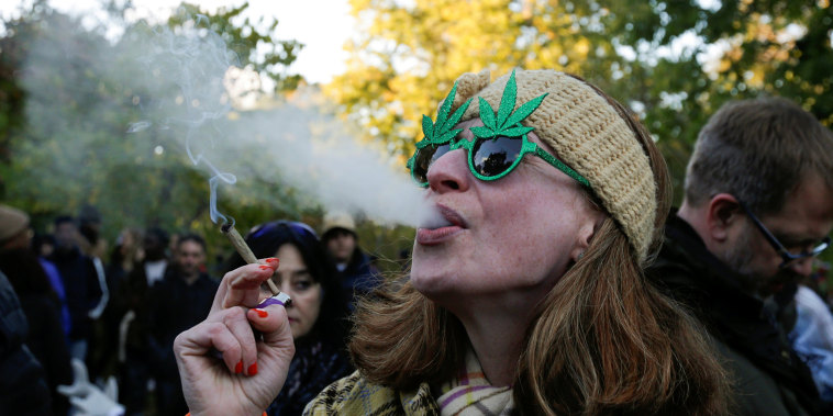 Image: A woman smokes a joint on the day Canada legalizes recreational marijuana at Trinity Bellwoods Park in Toronto