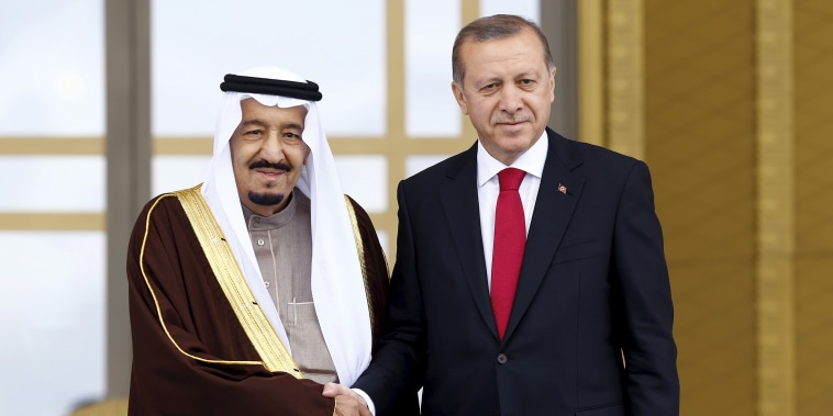 Image: Turkey's President Tayyip Erdogan and Saudi King Salman shake hands during a welcoming ceremony in Ankara, Turkey