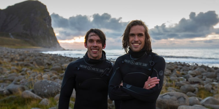 Image: Rolf and William Hellem surfing in the Lofoten islands, Norway.