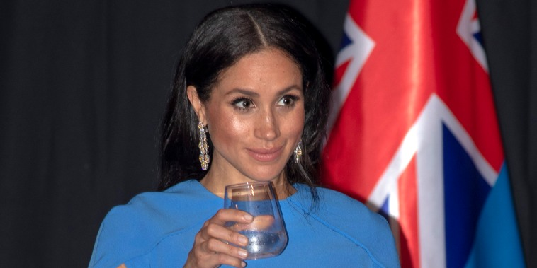 The former Meghan Markle wore a blue, caped dress during a state dinner in Fiji.