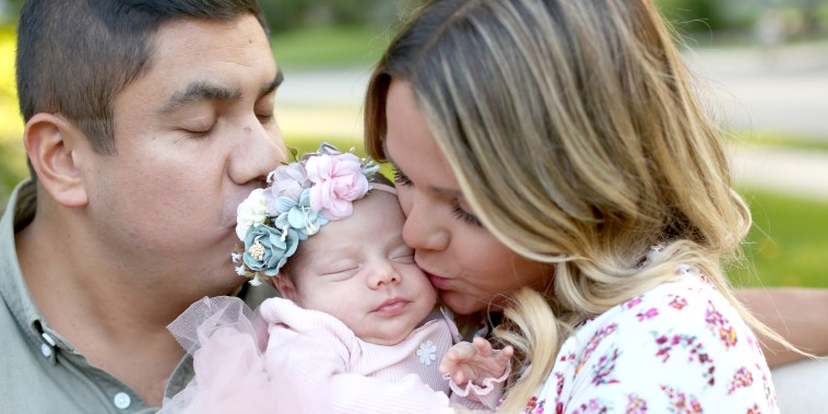 Lauren and Margarito Torres with their newborn daughter, Isa.