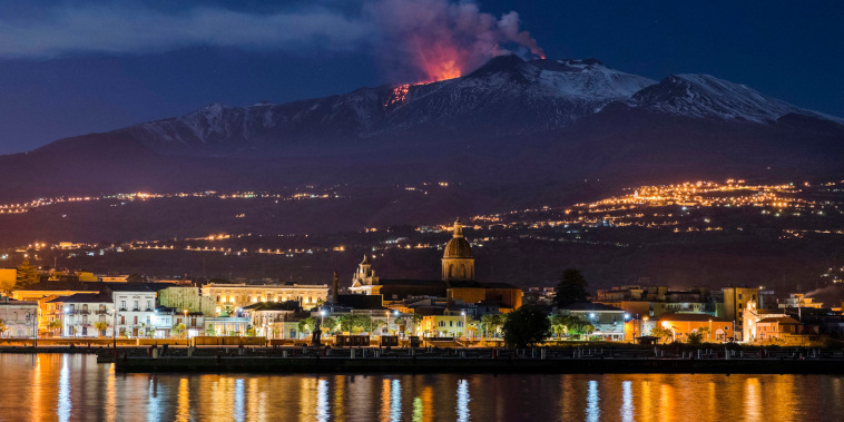 Image: Mount Etna spews lava as the Sicilian town of Riposto