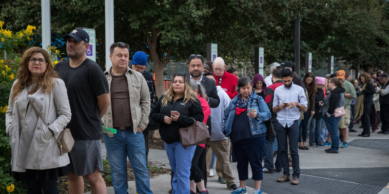 People wait at a polling place in Houston on Monday, the first day of early voting in Texas.