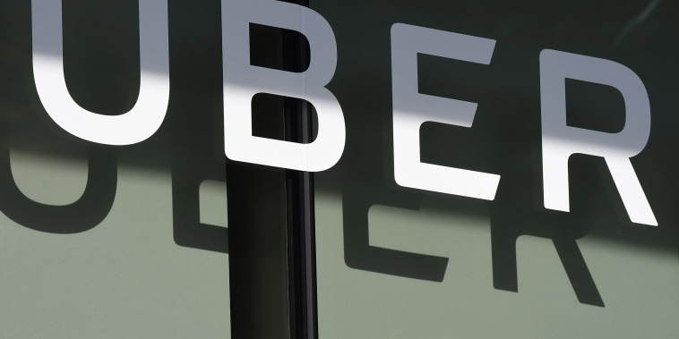 Image: The Uber logo is seen at the second annual Uber Elevate Summit, at the Skirball Center in Los Angeles