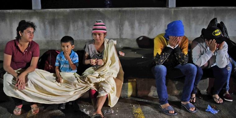 Image: TOPSHOT-EL SALVADOR-HONDURAS-US-MIGRANTS-DIPLOMACY