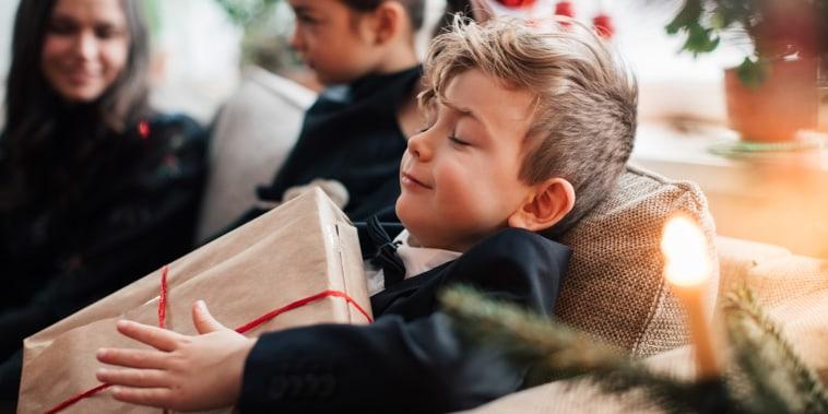 Boy opening presents