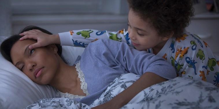 Child waking up sleeping mother