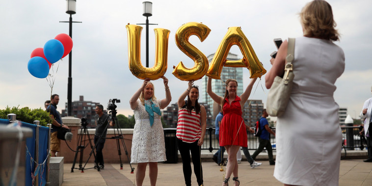 Image: Attendees hold up balloons spelling U.S.A at a Republicans Overseas event in London