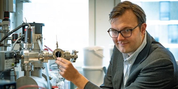 Image: Professor Kasper Moth-Poulsen holding a tube containing the catalyst