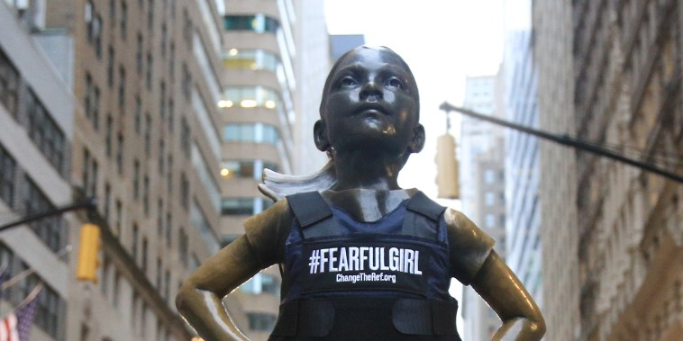 With #FearfulGirl, the statue now wears the vest aside the Wall Street Bull, with the goal of promoting sensible gun laws ahead Tuesday's elections.