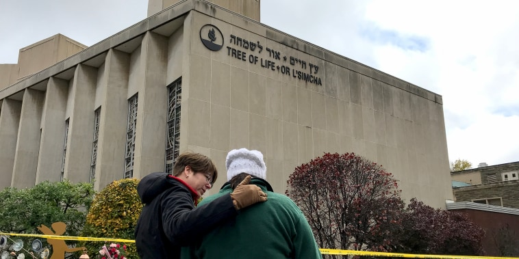 Hallie Goldstein is comforted by a Red Cross volunteer outside the Tree of Life Congregation, where she is a member. She said that those killed last week should have been there today, praying, eating bagels, and gossiping about the community.