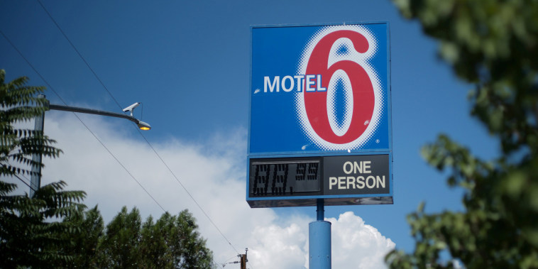 Image: A sign marks a Motel 6 property in Espanola